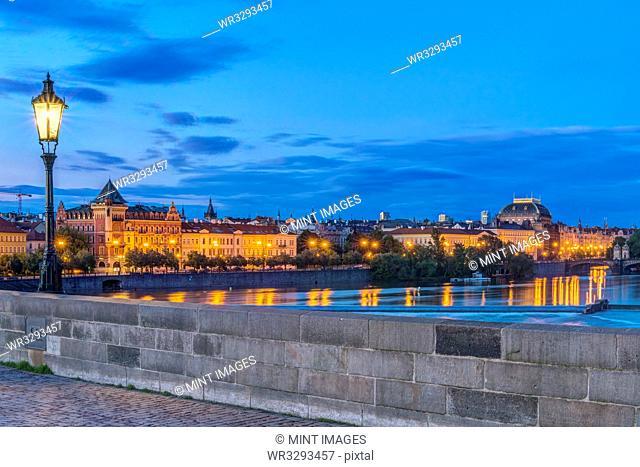 Charles Bridge and city illuminated at dawn, Prague, Czech Republic