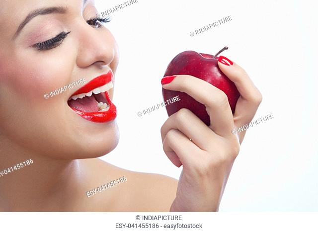 Woman about to eat an apple
