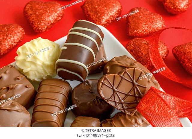 Assorted chocolates with red hearts