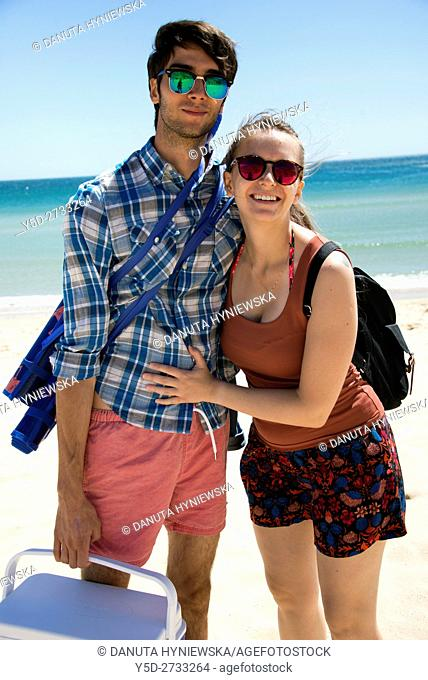 young couple on vacation at the beach, here Salema beach, Algarve, Portugal, Europe