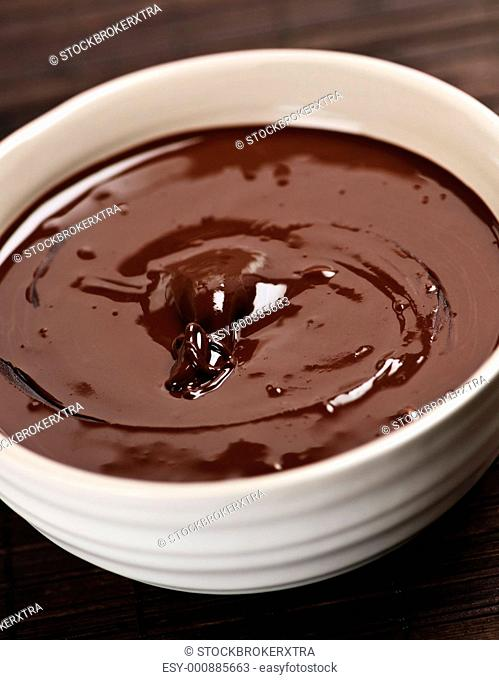 Bowl of soft melted rich dark chocolate