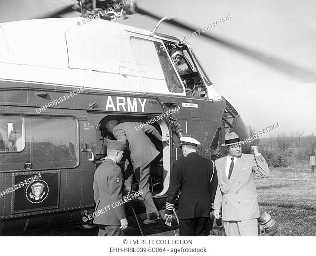 President Eisenhower enters an Army Helicopter. In 1957 Eisenhower began using a Bell UH-13-J Sioux to fly to the presidential retreat at Camp David and to his...