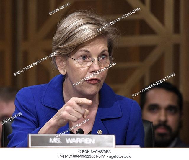 United States Senator Elizabeth Warren (Democrat of Massachusetts) questions Richard F. Smith, former Chairman and Chief Executive Officer, Equifax, Inc