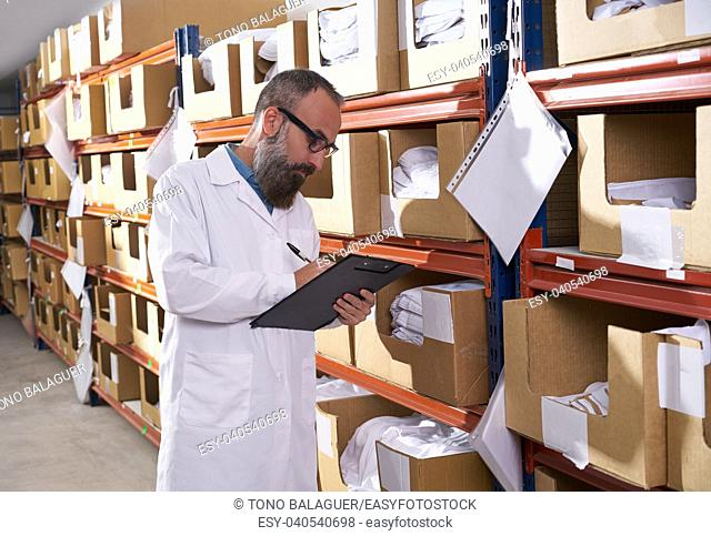 warehouse supervisor manager man in fashion textile factory with hipster beard