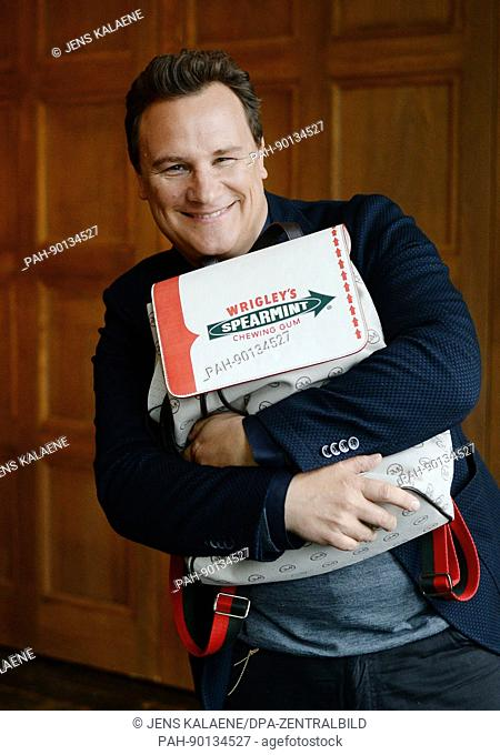 Fashion designer Guido Maria Kretschmer poses during the presentation of an XXL rucksack designed by him for Wrigleys Spearmint in Berlin, Germany