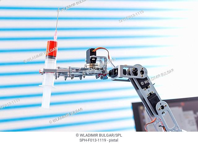 Robotic arm holding a syringe