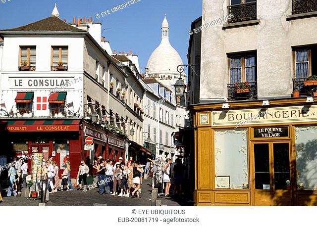 Montmartre Tourists in the narrow streets by the Restaurant Le Consulat near the Church of Sacre Coeur