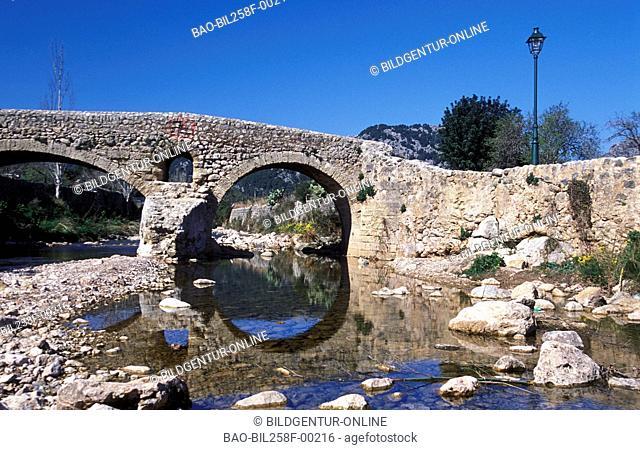 An old stone bridge in Pollenca in osten of the island Majorca in the Mediterranean Sea in Spain