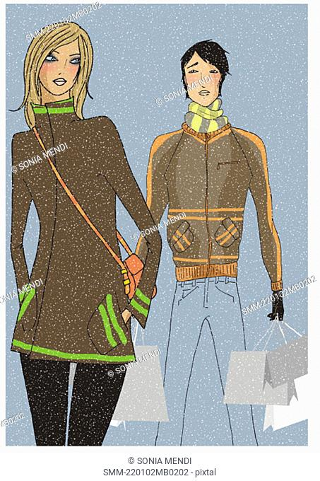 Young couple on a shopping trip in the snow