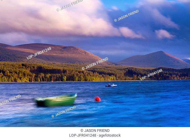 Scotland, Highland, Loch Morlich. A stormy evening on Loch Morlich with the Cairngorm Mountain Range in the distance