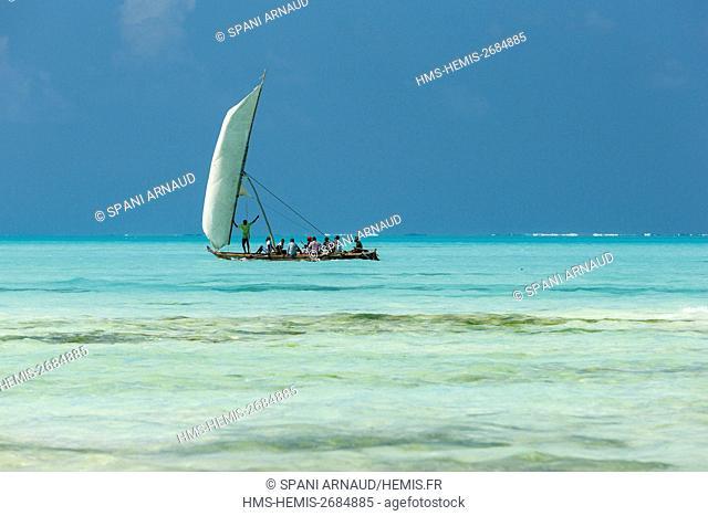 Tanzania, Zanzibar, Jambiani, boat sailing in turquoise waters