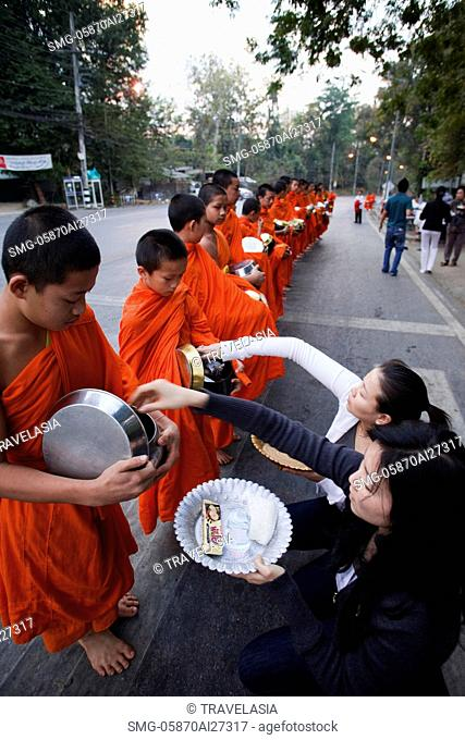 Thailand,Chiang Mai,Monks Receiving Offerings of Food