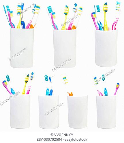collection of tooth brushes in ceramic glases isolated on white background
