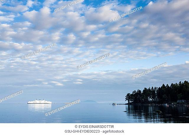 Large Ferry at Sea with Dappled Clouds in Sky, Gabriola Island, Canada