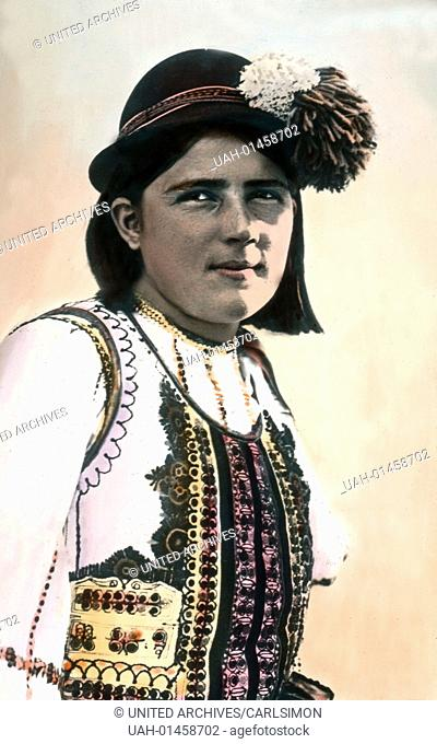 Romania, portrait of a girl in traditional costume, image date: circa 1920. Carl Simon Archive