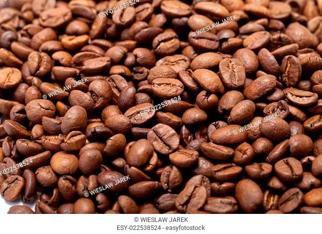 coffee beans close up isolated on white