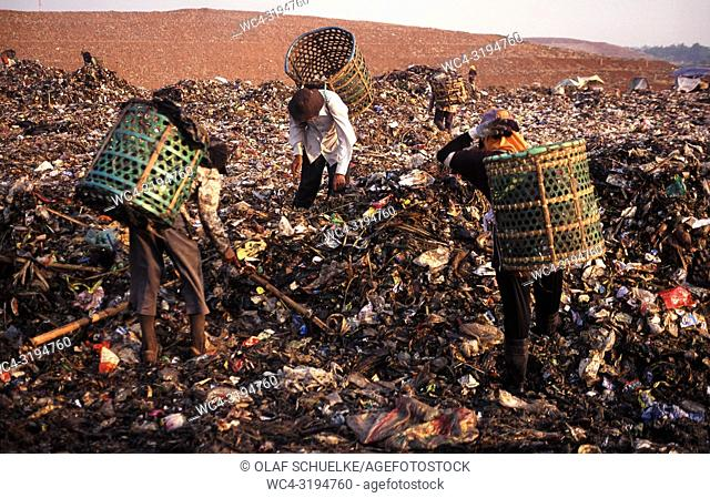 Jakarta, Java, Indonesia, Asia - Indonesian garbage collectors are searching for recyclable materials like plastic and metal at the Bantar Gebang garbage dump...