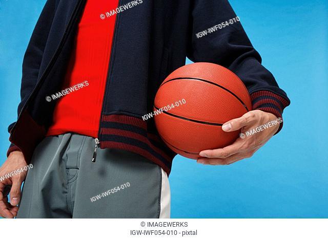 Man holding basketball, close-up