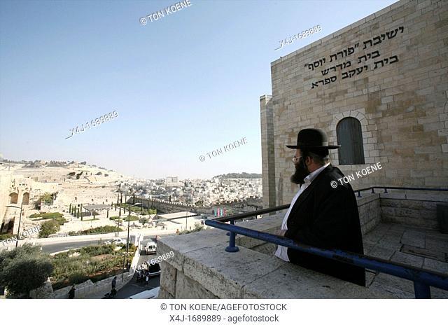A Jewish man at the Western wailing wall in Jerusalem
