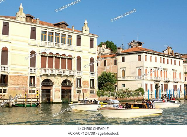 Water taxis in the Grand Canal, Venice, Italy