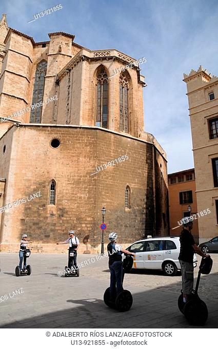 Tourists on segways, next to the Cathedral. Palma de Mallorca, Mallorca, Balearic Islands, Spain