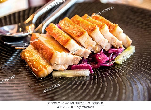 48HR Pork Belly.Crispy Pork Belly, Braised Red cabbage, Granny Smith Apple, Giant Capers.Bacchanalia. Restaurant. Singapore. Asia