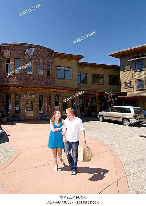A young couple shops in Powell river on the upper Sunshine coast, Vancouver coast and mountain region, British Columbia, Canada