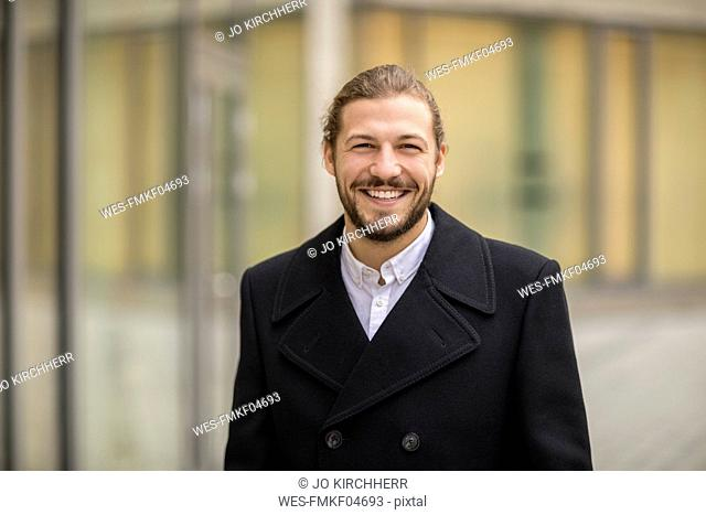 Portrait of laughing man in autumn