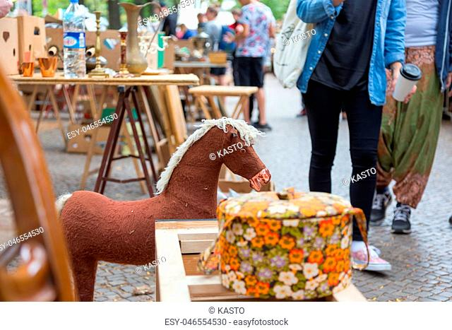 Market boot with objects beeing sold at weekend flea market in Berlin