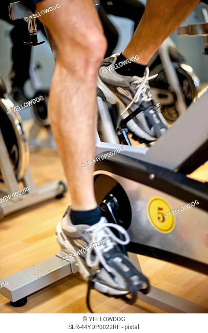 Man using spin machine in gym