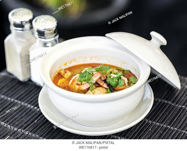 spicy red curry asian fresh seafood soup in phu quoc vietnam