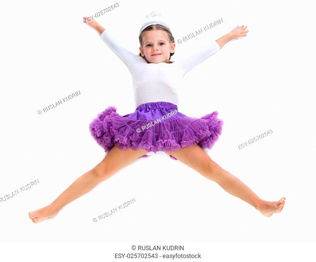 Little girl dancer lying on the floor in the shape of a star. Isolate on white