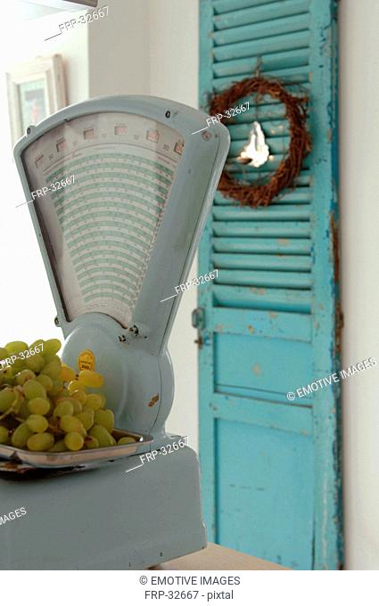 Bunch of grapes on scales