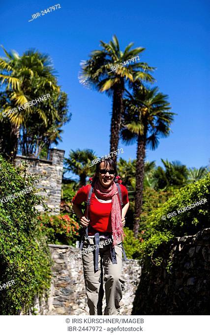 A woman hiking on the Scalinata della Ruga, ascent to Monte Verità, Ascona, Lake Maggiore, Lago Maggiore, Ticino, Switzerland, Europe
