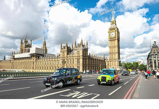 Taxis on the Westminster Bridge, Westminster Palace and Big Ben, London, England, Great Britain