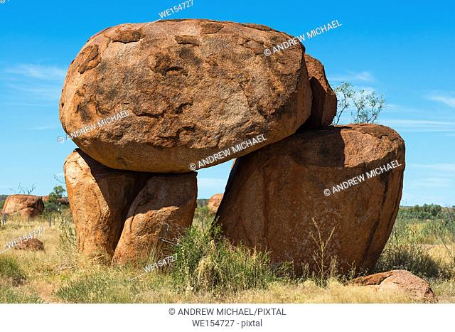 Devils Marbles - boulders of red granite are balanced on bedrock, Australia, Northern Territory