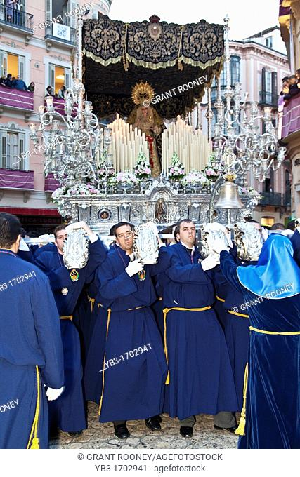 A Trono 'Float' being carried through the streets, Semana Santa Holy Week Malaga, Andalusia, Spain