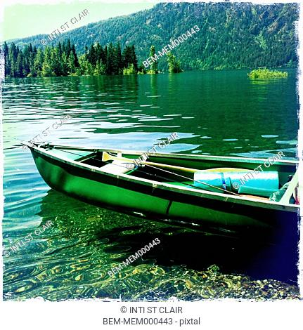 Canoe sitting in still lake, Cle Elum, Washington, United States