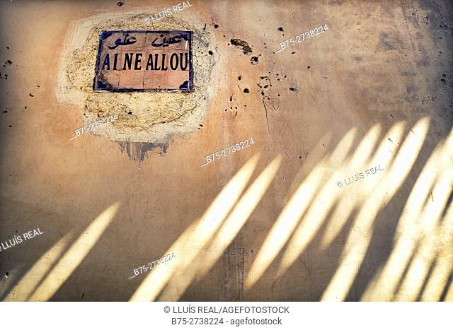 Wall with shadows, light reflections and street name plate Medina of Fez, Morocco