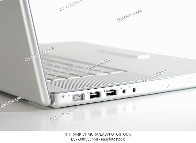 open thin silver laptop computer on white - side view