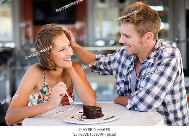 Couple sharing dessert at cafe