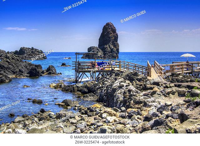 The beaches on stilts of Aci Trezza in Sicily Italy