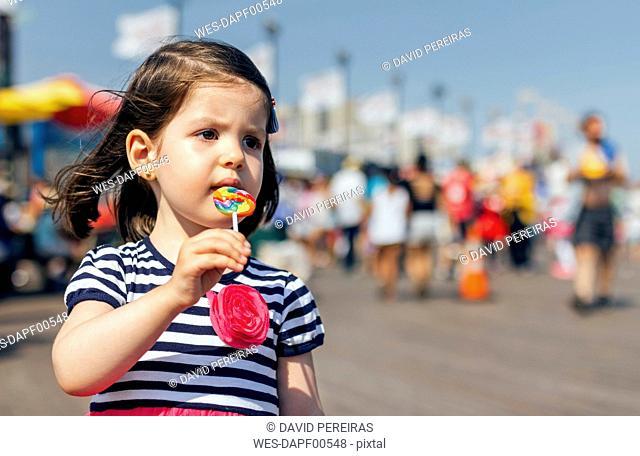 USA, New York, Coney Island, little girl with lollipop