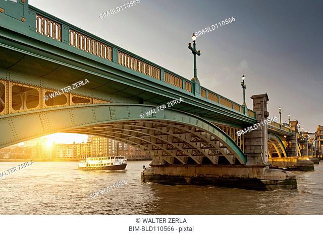 Boat and urban bridge