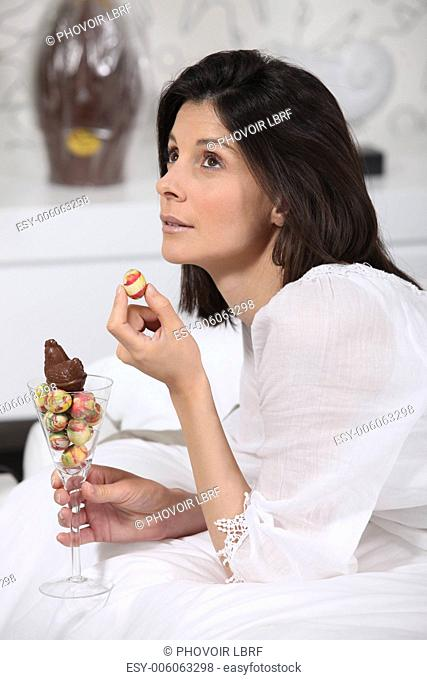 a woman eating Easter eggs