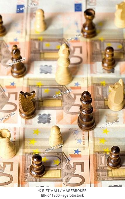 Chess pieces placed on Euro bills