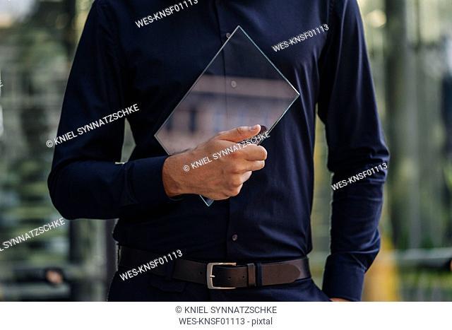 Businessman holding futuristic portable device