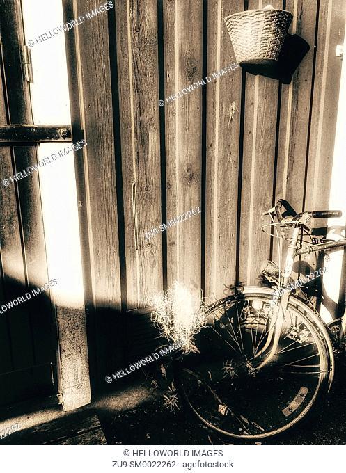 Bike outside rustic timber building, Sweden, Scandinavia