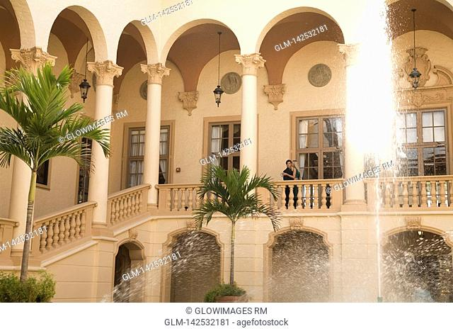 Couple romancing in the balcony, Biltmore Hotel, Coral Gables, Florida, USA