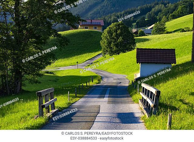 rustic road in a farm region in the Austrian Alps